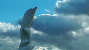 Dolphin Statue and Clouds Time Lapse. Video stock video