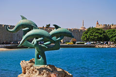 The dolphin statue in Rhodes Stock Image