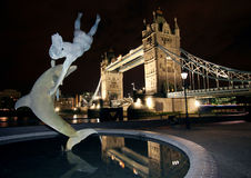 Dolphin Statue and Tower Bridge, at Night London. Royalty Free Stock Photography