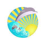 Dolphin. Swims out on waves of sea and sun is shining Royalty Free Stock Photos