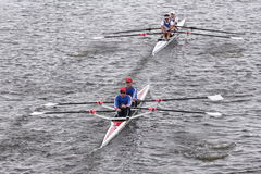 Dolphin (top) and Don Rowing (Bottom) races in the Head of Charles Regatta Men's Master Doubles Royalty Free Stock Photos