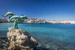 Dolphine Sculpture at the Port in the City of Rhodes, Greece Royalty Free Stock Photo