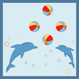Dolphins. Two cute dolphis juggling colorful beach salls Royalty Free Stock Photos