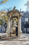 The dolphins fountain in Largo Do Carmo. Stock Photography