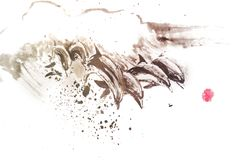 Dolphins painted with ink stock images
