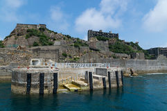Dolphon Pier of Gunkanjima (Hashima). Hashima Island, commonly called Gunkanjima (meaning Battleship Island), is former coal mining island. It's one of the Royalty Free Stock Photography