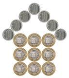 Dom budujący monety zdjęcia royalty free