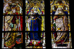 Dom of Cologne stained glass. Stained glass window in the Dom of Cologne, Germany, depicting Mother Mary and the Child and Saint Peter and Saint Elisabeth of Royalty Free Stock Images