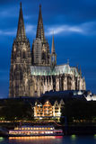 Dom in Cologne at sunset. Dom in Cologne with boat on the river Rhine at sunset lighting Stock Photos