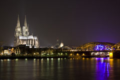 Dom and Great St. Martin church in Cologne. At night lighting with reflection in river Rhine Royalty Free Stock Photos
