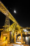 Dom Joao yellow bridge. Dom Joao bridge in Porto with its traditional yello color at night and full moon Royalty Free Stock Image