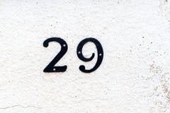 Dom 29 liczb na textured ścianie Obraz Royalty Free