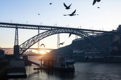 Dom Luis I bridge and Douro river at sunrise, Porto Royalty Free Stock Photo