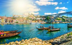 Rio Douro river in Porto an sunset. Dom Luis I bridge and traditional boats on Rio Douro river in Porto, Portugal royalty free stock image