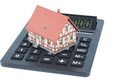 Dom na kalkulatorze zdjęcia stock