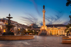 Dom Pedro IV square in Lisbon at dusk. Also know as Rossio. Dona Maria II National Theatre in the background. Lisboa, Portugal Royalty Free Stock Image