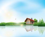 Dom przy jeziorem Zdjęcia Royalty Free