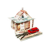 Dom robić banknoty z zabawkarskim samochodem i wiązka klucze Obrazy Royalty Free