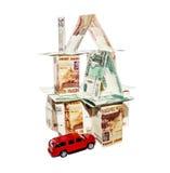 Dom robić banknoty z zabawkarskim samochodem Fotografia Royalty Free
