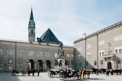 Dom Square with horse carriages Stock Images