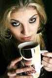 Dom02. Blond woman drinking a cup of coffee Royalty Free Stock Photography