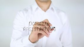 Domain Registration, Man Writing on Glass royalty free stock photo