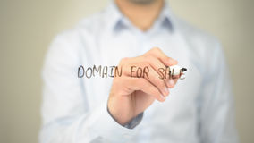 Domain For Sale , man writing on transparent screen. High quality royalty free stock photo