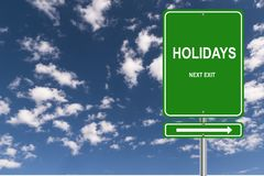 Holidays next exit. Green highway direction sign with white text graphics holidays next exit against blue skies royalty free illustration