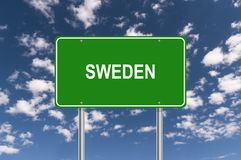 Sweden signpost. Against blue cloudy sky stock images