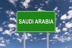 Saudi Arabia sign. Saudi Arabia road sign against blue sky royalty free stock image