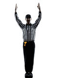 Domarelandningsögonblicken för amerikansk fotboll gör en gest konturer Arkivfoto