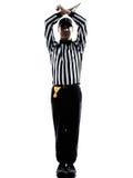 Domaren för amerikansk fotboll gör en gest konturn för det personliga ojusta spelet Royaltyfri Foto