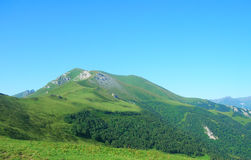 dombay sofrudzhu βουνών ημέρας Καύκασου ηλιόλουστο Στοκ Φωτογραφίες