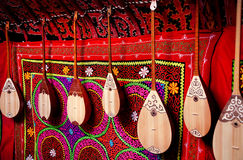 Dombra instrument in Kazakh yurt interior. Dombra string instruments on the wall of Kazakh yurt at Nauryz celebration in Almaty, Kazakhstan Stock Image