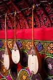Dombra instrument in Kazakh yurt interior. Dombra string instruments on the wall of Kazakh yurt at Nauryz celebration in Almaty, Kazakhstan Royalty Free Stock Image