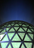 Dome. Abstract dome with green glass and a blug noise background Stock Image