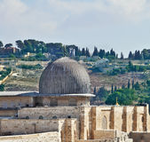 The dome of the Al Aqsa Mosque. The ancient walls of Jerusalem, lit morning sun. The dome of the Al Aqsa Mosque on the Temple Mount in Jerusalem Royalty Free Stock Images
