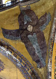 Dome angel figure Hagia Sophia. The figure is one of four six winged angel figures surrounding the base of the dome in the Sophia Hagia, Istanbul, Turkey.  These Royalty Free Stock Photo
