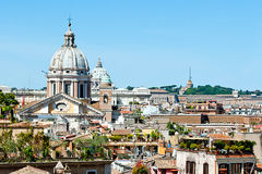 Dome of basilica in rome. View of dome of basilica over of roofs of Rome city stock images