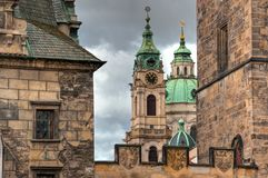 Dome and bell tower of a medieval castle from the ancient wall close up. Prague royalty free stock photo