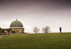 Dome building and person in Calton Hill, Edinburgh Stock Images