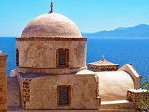Dome of a Byzantine Church in Monemvasia, Greece. The sunlit dome of a Byzantine Church in the medieval village of Monemvasia, Greece Royalty Free Stock Photography