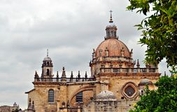 Dome of a cathedral. Detail of dome of a cathedral and rosettes of sherry with clouds in the sky Stock Images