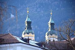 Dome of the Cathedral mountains in the background. Church in Brixen, Italy, with Alps as background Stock Photo