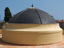 Dome of catholic Chucho with a blue sky as background royalty free stock photography