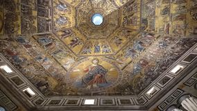Dome ceiling with golden mosaic icons. Interior details of the gold mosaics that decorate the dome ceiling of the baptistery in Florence Royalty Free Stock Photography