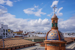 The dome of the chapel El Carmen and the roofs of Seville Royalty Free Stock Photo