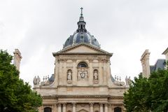The dome of the Chapel of the Sorbonne University against the grey sky in Paris. PARIS, FRANCE — April 12, 2015: The dome of the Chapel of the Sorbonne stock image