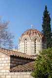 Dome of the Christian Orthodox Church. Cross the top tiles on the roof stone building small windows stock image