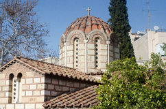 Dome of the Christian Orthodox Church. Cross the top tiles on the roof stone building small windows royalty free stock photo